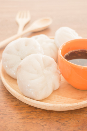 stuff: Steamed dumpling stuff on wooden plate, photo