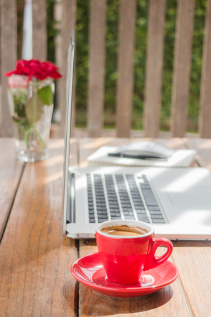 work station: Hot coffee cup on wooden work station, stock photo