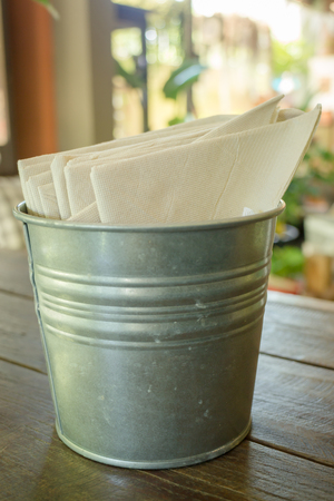 tissue paper: Tissue paper in bucket on wooden table, stock photo