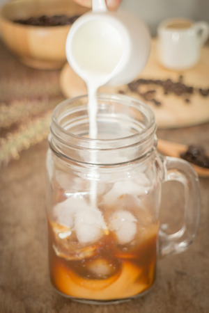 milk pouring: Milk pouring for fresh iced coffee, stock photo