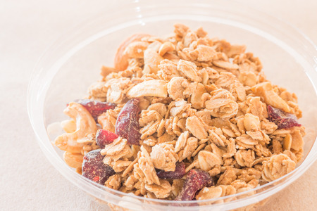 Homemade granola breakfast with dried fruit, stock photo