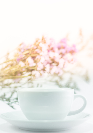 static: White mug cup and static flower, stock photo Stock Photo