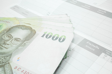 bank records: Thai money banknote on record table note book, stock photo