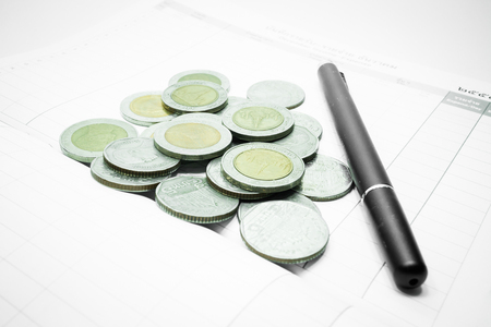 bank records: Group of Thai baht coins on the note book, stock photo Stock Photo