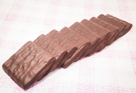 chocolate pieces: Stack of milk chocolate pieces, stock photo Stock Photo