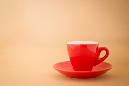 tomando café: Beautiful red cup of coffee on vintage background, stock photo Foto de archivo