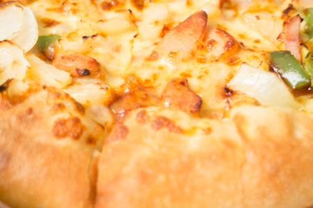 Delicious pizza pan with cheese crust , stock photo