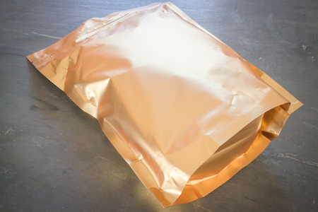 golden bean: Golden aluminum bag of premium coffee bean, stock photo Stock Photo