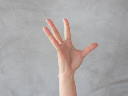 education help: Hand action gesture on grey background, stock photo Stock Photo