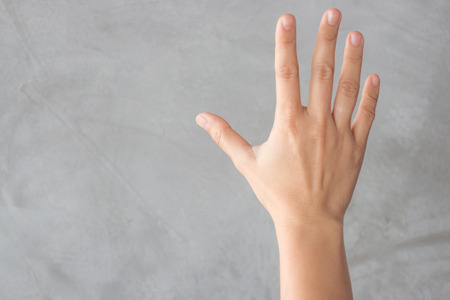 fingerspelling: Hand action gesture on grey background, stock photo Stock Photo