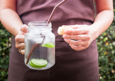 scone: Butter scone and lime Infused detox water, stock photo
