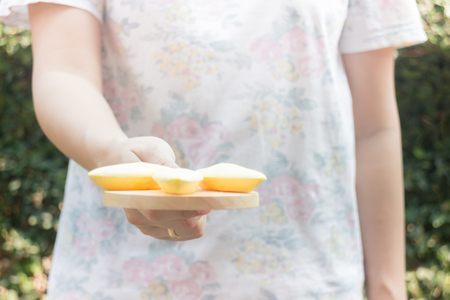 chilled out: Hand on serving Thai traditional york cookies, stock photo