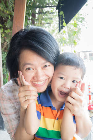 chilled out: Cute asian boy and his aunt, stock photo
