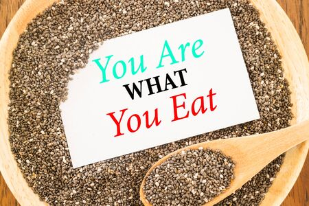 what to eat: You are what you eat quote on chia seeds and business card, stock photo Stock Photo