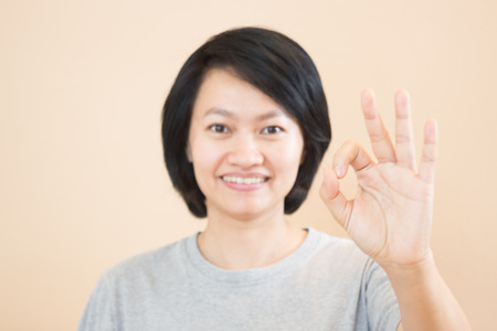 gesticulation: Asian woman hand action gesture, stock photo