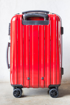 outgoing: Red travel suitcase for outgoing, stock photo