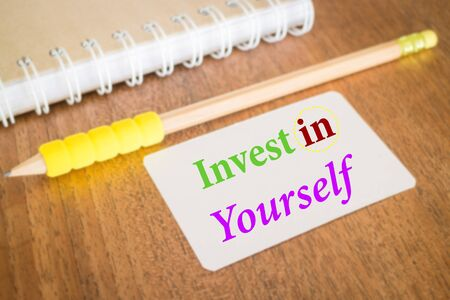 stock quote: Invest in yourself. Inspire quote about education, stock photo