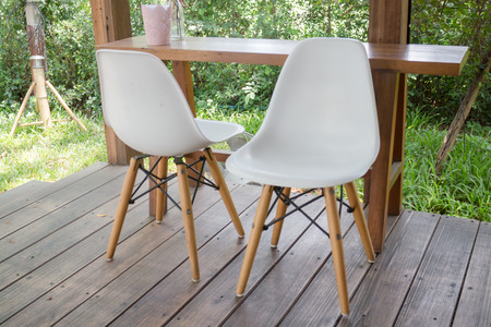 chilled out: Wooden table and modern chair, stock photo Stock Photo