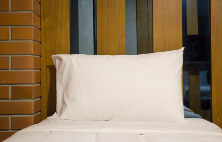 bedding: White bedding sheet and pillow, stock photo