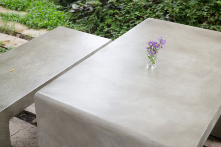 Concrete outdoor furniture set in the small garden, stock photo