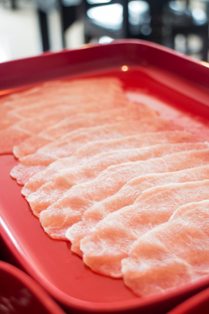 Raw sliced pork preparing for homemade sukiyaki, stock photo Stock Photo