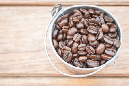 Roasted coffee beans in bucket, stock photo Stock Photo
