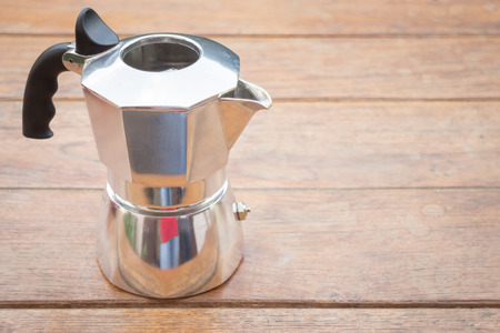 Metal coffee maker on wooden table, stock photo Stock Photo