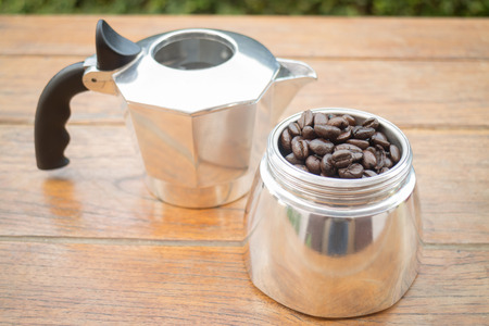 Roasted coffee beans in moka pot, stock photo Stock Photo