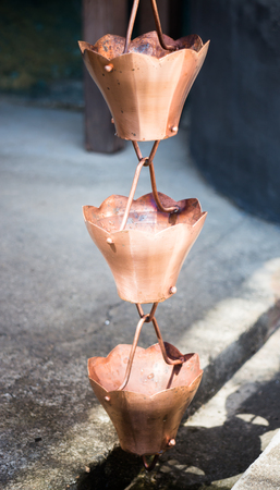 wayout: Vintage metallic bells used for rain waters way-out in zen garden