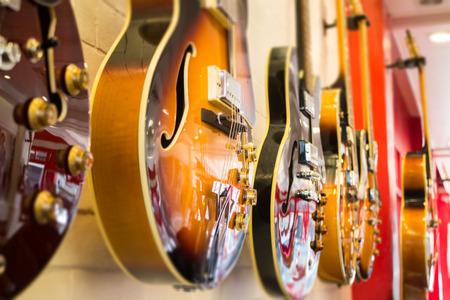 funk music: Beautiful sunburst electric guitar in the shop, stock photo Stock Photo