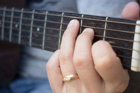 Guitarist Hand Playing Acoustic Guitar, stock photo