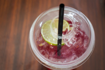 Cold Red Drink With Lime Slice, stock photo