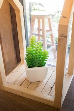Artificial plastic plant leaves vase, stock photo