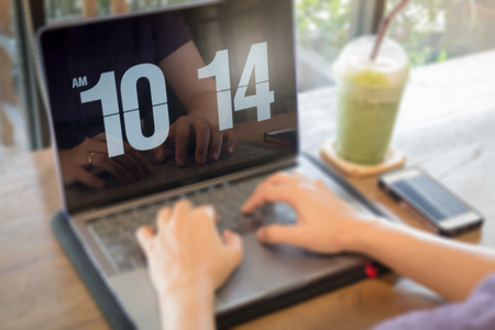 Woman using laptop in the coffee shop, stock photo