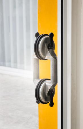 appliances: Glass sucker applied for door handle, stock photo Stock Photo