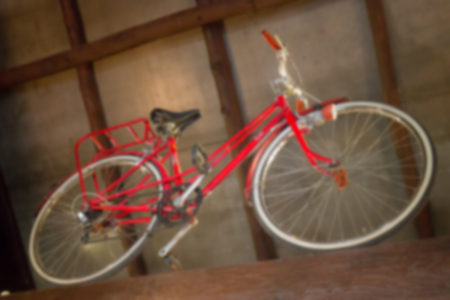 Red retro bicycle showed on the ceiling, stock photo