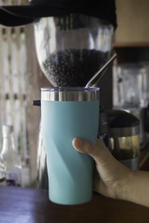 Hand holding coffee reuse glass, stock photo Stok Fotoğraf