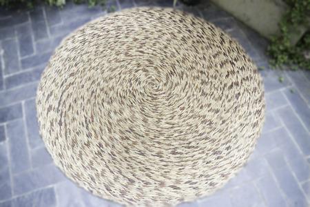Woven mat in outdoors garden