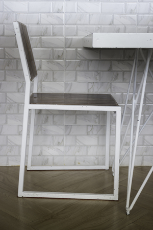 Room ambiance with white metal table and  chair, stock photo Standard-Bild