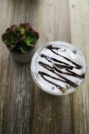 Iced mocha coffee on wooden table, stock photo