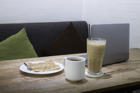 Easy meal in work hour with coffee drink and fried roti, stock photo