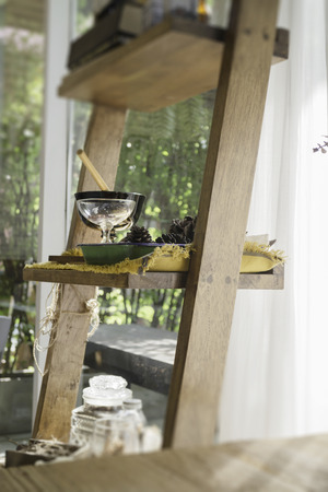 Stepladder with seed and dry herbs room decoration, stock photo Standard-Bild