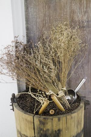 Roasted coffee bean in wood bucket, stock photo