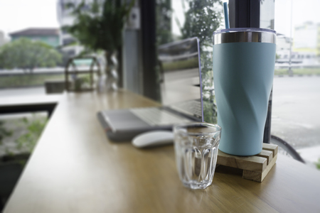 Work table with laptop and drink, stock photo Standard-Bild