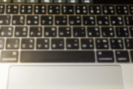 Blur laptop or notebook computer keyboard vintage concept, stock photo Standard-Bild