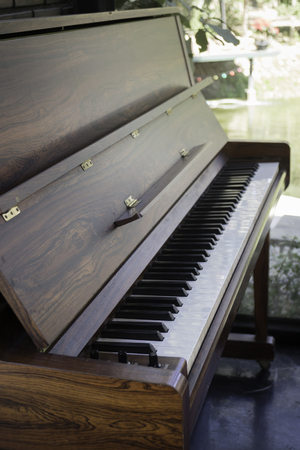 Piano keyboard of an old music instrument, stock photo