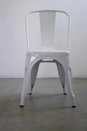 White steel chair in white room, stock photo