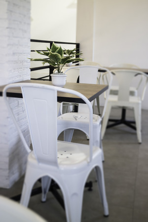 White steel chair and wooden table, stock photo Standard-Bild
