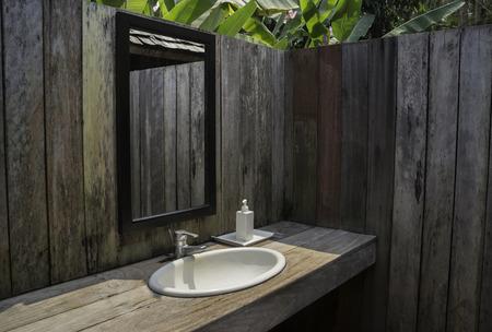 Outdoor bathroom with tropical garden