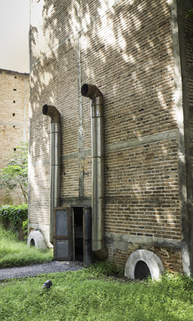 Zinc gate with old bricks wall and grass field. 写真素材